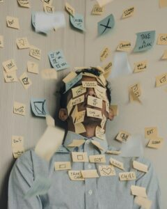 Man with post-it notes on his face